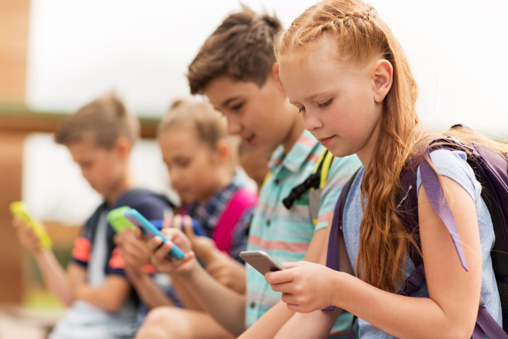 Children at school using cellphones